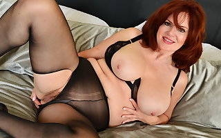 Redhead milf Andi James pleasures her grown-up pussy