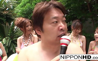 A bunch of Japanese bikini babes shot a wrestling match!