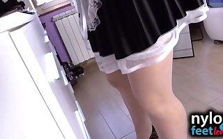 Sexy maid in white stockings licks brunette's nylon feet